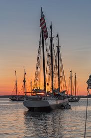 Wood Boats Lined Up In Sunset - At Historic Wooden Boat Gathering In Maine