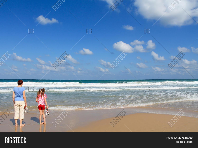 On beach granny Category:Nude women
