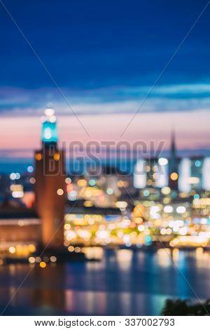 Stockholm, Sweden. Night Skyline Abstract Boke Bokeh Background. Design Backdrop. Tower Of Stockholm