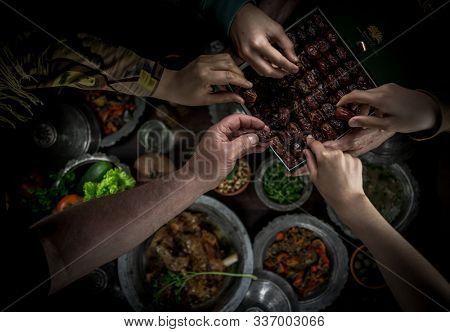 Eating dates is what Muslim family first do before iftar in Ramadan