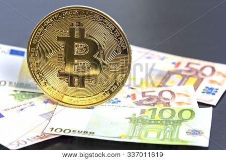 Bitcoin Crypto Currency. Golden Bitcoin On Euro Banknotebackground. Bitcoin Crypto Currency, Blockch