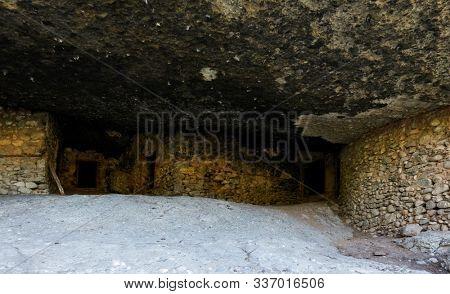 Abodes of ancient orthodox hermits in cave near Kastraki village in Meteora, Greece