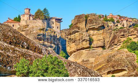 Orthodox monasteries of Varlaam and The Great Meteoron on the rocks in Meteora, Greece - Greek landscape