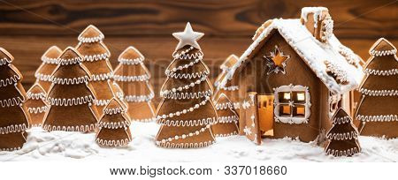 Gingerbread house and christmas fir trees winter holiday celebration concept