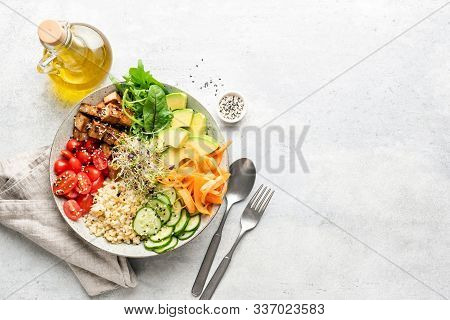 Vegetarian Vegan Salad Bowl Or Buddha Bowl With Grains, Tofu, Avocado, Vegetables And Greens. Balanc