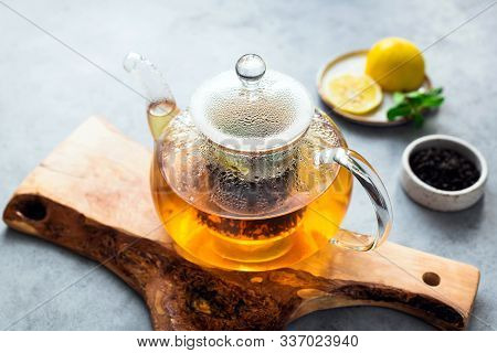 Tea In Glass Tea Pot With Lemon And Mint. Fresh Tea Brew, Herbal Tea