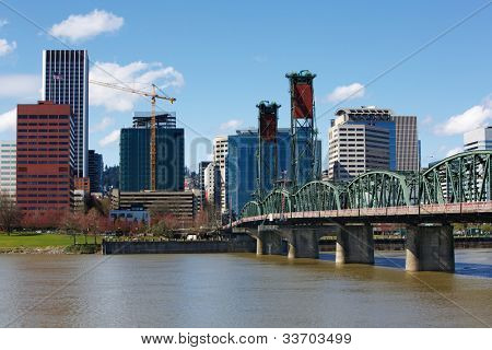 Portland City Green Steel Bridge and skyline with construction crane