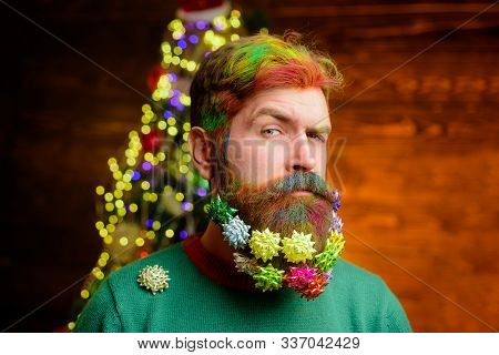 Merry Christmas And Happy New Year. Decorated Beard. Serious Bearded Man With Decorated Beard. Chris