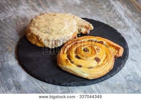 Pain Aux Raisins On Display On A Rustic Wooden Table. A Pain Aux Raisins Is A Typical Breakfast Fren