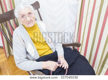 Elderly Lady In Chair