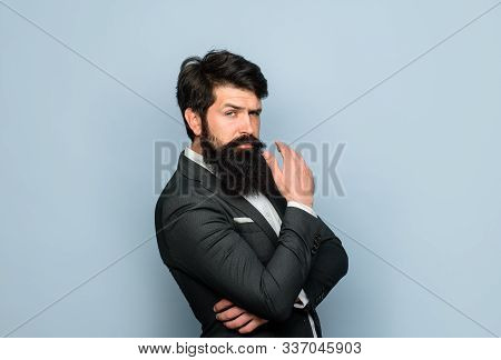 Concentrated Bearded Man Thinking About Something. Thoughtful Expression. Thinking Businessman. Pens