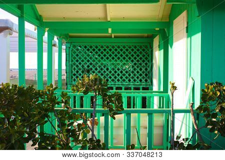 Elegant Green Wooden Structure In A Deserted And Desolate Bathhouse. Booths For Changing Swimmers' C