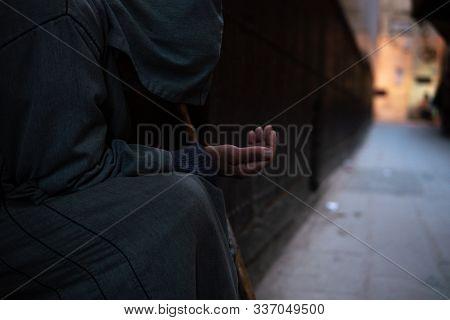 A Poor Beggar Man In Traditional Moroccan Hoody Djellaba Outfit. Fokiya, Jellaba. Anonymous Poor Beg