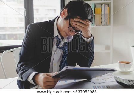 Tired And Frustrated Stressed Asian Young Employee Businessman Working Finance About Cost With Clipb