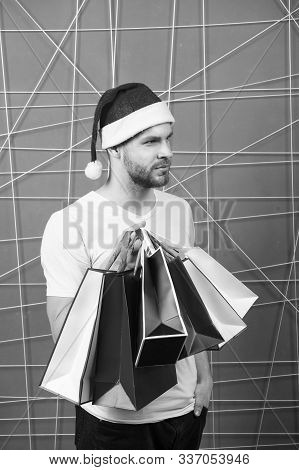 Winter Holidays Celebration. Man Santa With Shopping Bags On Pink Background. Christmas, New Year Gi