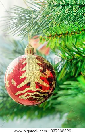 Red Christmas Ball, Toy Decoration, Hanging On The Green Branch Of Christmas Tree. Close Up. Great B