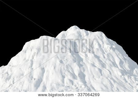White Snow Heaped In A Pile On A Black Background. Snow Hill