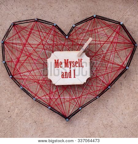 Close-up Of Red Heart Made Of Threads, Stranded Between The Nails. Phrase Written On A Wooden Card: