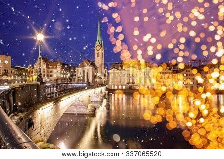 christmas lights over scenic view of historic Zurich city center with famous Fraumunster and Grossmunster Churches and river Limmat at Lake Zurich, Canton of Zurich, Switzerland