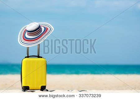 Summer Travel And Plan With Yellow Suitcase Luggage In The Sand Beach. Travel In The Holiday Trips,