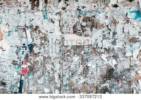 Torn paper on bulletin board as grunge texture and background, abstract worn pattern backdrop poster