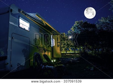 Summer Night Rv Camping. Recreational Vehicle Class C Motorhome Under Starry Sky. Campground Rv Park