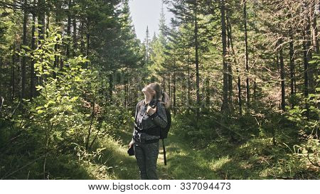 Traveler Photographing Scenic View In Forest. One Caucasian Woman Shooting Nice Magic Look. Girl Tak
