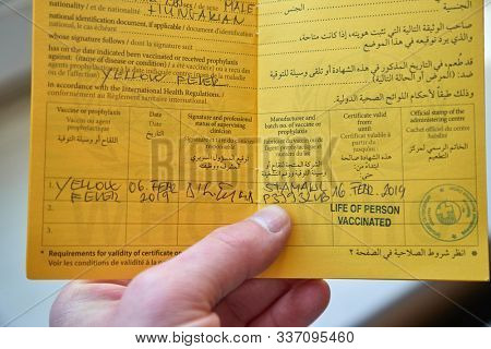 BUDAPEST, HUNGARY - MARCH 30, 2019: Vaccination certificate booklet issued by WHO listing vaccines given as preparation for traveling around the world
