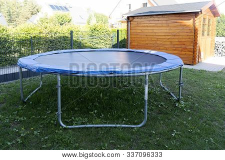 Home Street Trampoline On An Aluminum Frame, Black With A Blue Border. Children's Trampoline For Jum
