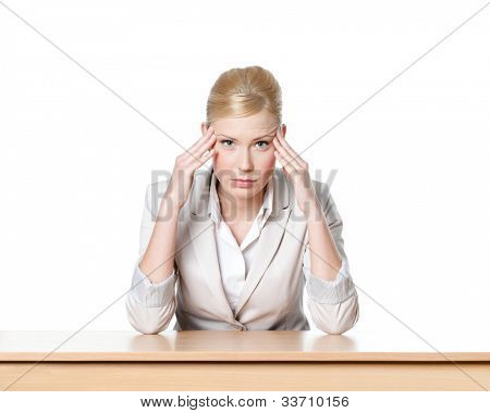 Young business woman sitting at a table, isolated