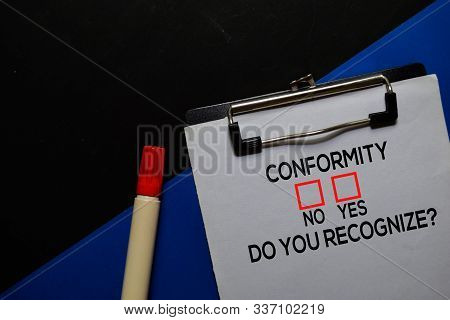 Conformity, Do You Recognize? Yes Or No. On Office Desk Background