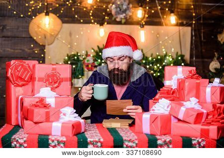 Man Bearded Santa Claus Hat Reading Letters. Generous New Year. Lot Of Gifts. Happy Winter Holidays.