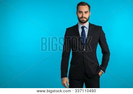 Copy Space. Portrait Of Young Successful Confident Businessman With Beard Isolated On Blue Studio Ba