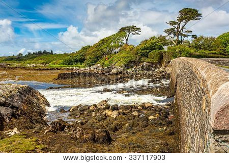 Adbear Salty Lake Its Limestone Bridge, Stones And Sediments On The Shore With A Low Flow Of The Inc