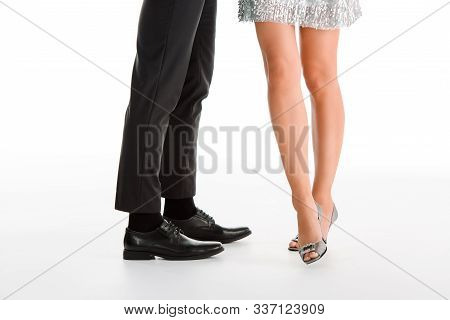 cropped view of aristocratic couple standing isolated on white poster