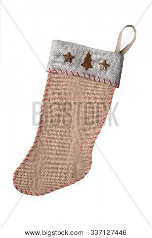Homemade old fashioned burlap Christmas Stocking isolated on whtie.