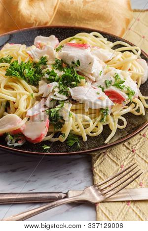 Italian Crab Scampi Over Linguine Pasta With Parsley Garnish