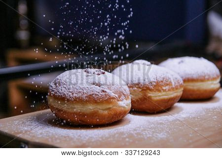 Hanukkah Food Doughnuts With Jelly And Sugar Powder With Bookeh Background. Jewish Holiday Hanukkah