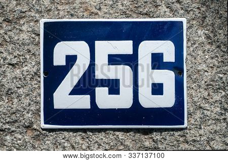 Weathered Grunge Square Metal Enameled Plate Of Number Of Street Address With Number 256 Closeup