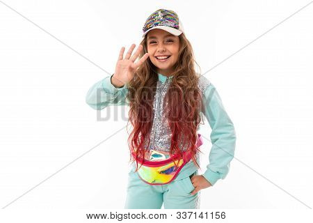 Little Pretty Caucasian Girl In A Tracksuit Waving Hand, Picture Isolated On White Background.