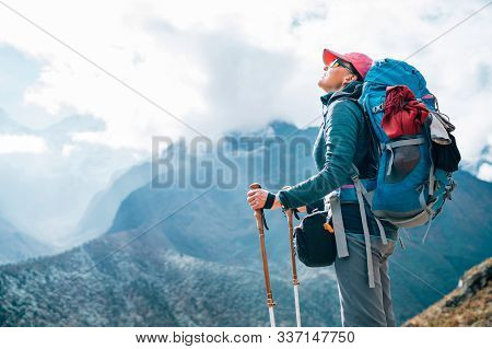 Young Hiker Backpacker Female Enjoying The Valley And Mountains View During High Altitude Acclimatiz