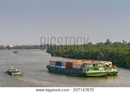 Ho Chi Minh City, Vietnam - March 13, 2019: Sunset Sky Shot Over Song Sai Gon River. Green Loaded Co