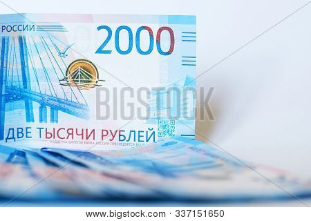 New Cash Banknotes Of Russia On A White Background. The Face Value Of The Banknote Is 2000 Rubles. T