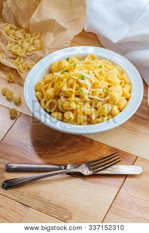 Delicious Macaroni And Cheddar Cheese Shell Noodles In A Bowl