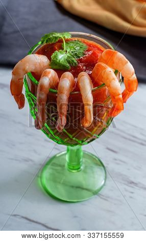 Delightful Tail-on Shrimp Cocktail Served With Horseradish Dipping Sauce In Glass Cup