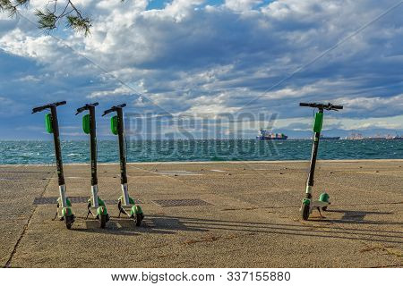 Thessaloniki, Greece - November 30 2019: Parked Lime Electric Scooter Rentals Without Passenger. Gre