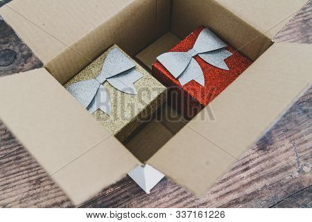 Festive Christmas Shopping Online Conceptual Still-life, Presents Or Gift Boxes Inside Delivery Parc