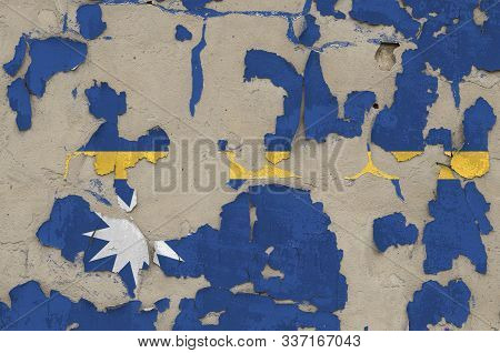 Nauru flag depicted in paint colors on old obsolete messy concrete wall closeup. Textured banner on rough background poster
