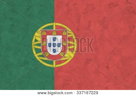 Portugal flag depicted in bright paint colors on old relief plastering wall. Textured banner on rough background poster
