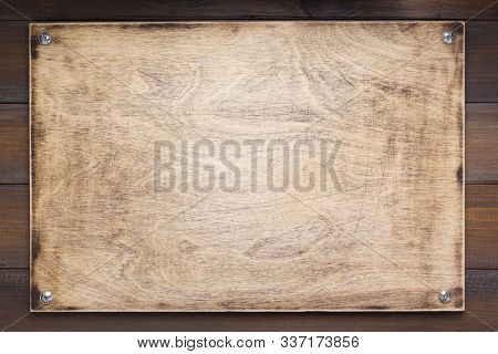 nameplate at wooden background texture, on plank board wall
